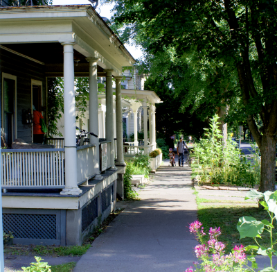 Fall Creek Apartments with porches along the sidewalk on Aurora Street
