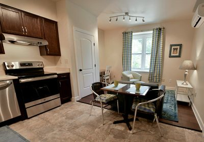 Living/dining area in one of the 404 Stewart Avenue apartments.